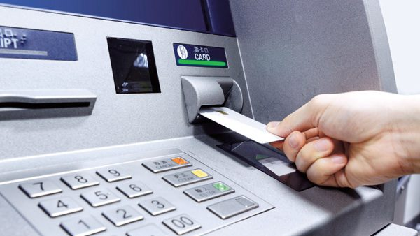 ATM - person inserting card on ATM machine