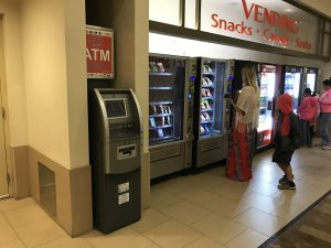 ATM placement with topper at shopping center photo near vending machines