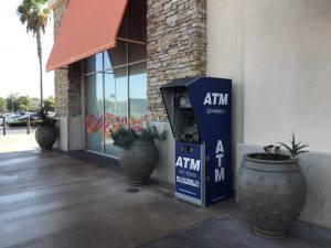 NationalLink ATM Processing - ATM with enclosure placement at retail location photo