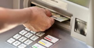 ATM hand getting cash from ATM machine Mastercard Cash Pick Up Photo