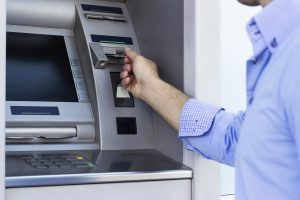 NationalLink ATM - man using ATM insert card into EMV card reader photo