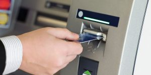 ATM Machines - Person Hand Insert Card ATM Machine Photo