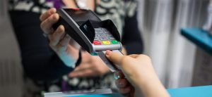 NationalLink Merchant Services Debit and EBT Solutions - Person Paying With EMV Credit Card Photo