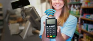 Merchant Services Wireless Payment Solutions - Girl Holding POS Terminal Photo