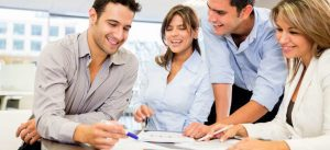 Merchant Service Company Partnership Program - Smiling People Working Together Business Attire Photo